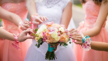 what to wear with a coral dress to a wedding